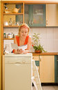 Woman with new kitchen appliance Stock Image