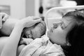Woman with newborn baby right after delivery black and white shot of young women Stock Image