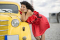 Woman in nice dress rely on car yellow Royalty Free Stock Images
