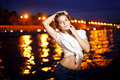 Woman and night city ligthts beautiful on the background of Royalty Free Stock Photo