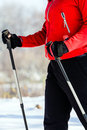 Woman nordic walking in winter, healthy lifestyle Royalty Free Stock Images