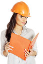 Woman with a notebook the in the construction helmet in hand Royalty Free Stock Images