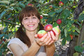 A woman offering apples Royalty Free Stock Photos