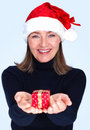 Woman offering Christmas gift isolated on white Stock Image