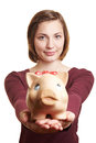 Woman offering piggy bank Stock Photo
