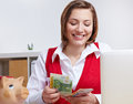 Woman in office counting money Stock Photos
