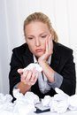 Woman in office with crumpled paper Royalty Free Stock Images