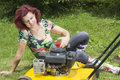 Woman oiling lawn mover Stock Images