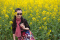 Woman and oilseed rape flowers Royalty Free Stock Photo