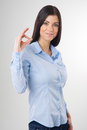 Woman with okay gesture smiling Stock Photo