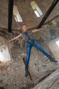 Woman at the old building jumping young blond into air in with ruined walls Stock Image