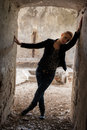 Woman at the old building young blond posing in with ruined walls Royalty Free Stock Photography