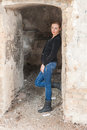 Woman at the old building young blond posing in with ruined walls Royalty Free Stock Photos