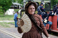 Woman old fashioned clothing fan walks past trainload union soldiers hesston steam show days day event showcase families Royalty Free Stock Photography