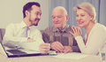 Woman and old man consider contract Royalty Free Stock Photo