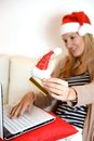 Woman online christmas shopping with computer and credit card young Stock Photography