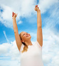 Woman with open arms against the sky Royalty Free Stock Image