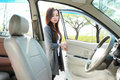 Woman open the car door Royalty Free Stock Photo