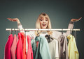 Woman with open hands palms in mall or wardrobe happy smiling pretty for copy space gorgeous young girl customer shopping shop Royalty Free Stock Images
