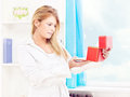 Woman opening fancy box at home Royalty Free Stock Photos