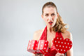 Woman opening the gift and is disappointed unhappy Royalty Free Stock Images