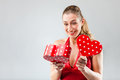 Woman opening the gift and is happy smiling Royalty Free Stock Image