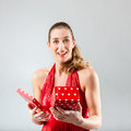 Woman opening the gift and is happy smiling Royalty Free Stock Images
