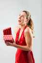 Woman opening the gift and is happy smiling Stock Photo