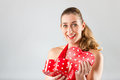 Woman opening present for valentines day Royalty Free Stock Photo