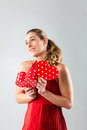 Woman opening present for valentines day Royalty Free Stock Photography