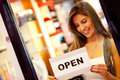 Woman opening a retail store Royalty Free Stock Photo