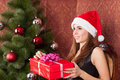 Woman opens a christmas gift Stock Photos