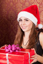 Woman opens a christmas gift Royalty Free Stock Photos