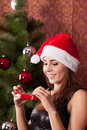Woman opens a christmas gift Stock Photography