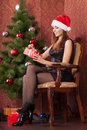Woman opens a christmas gift Royalty Free Stock Photography
