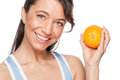 Woman with orange Royalty Free Stock Photography