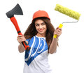 Woman in orange construction safety hat show axe paint brush Royalty Free Stock Photo