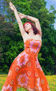 Woman in an orange dress Royalty Free Stock Photography