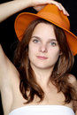 Woman with orange hat Stock Images