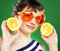 Woman with oranges fun over green background Royalty Free Stock Photography