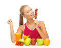 Woman with organic food eating strawberry young or fruits Royalty Free Stock Images