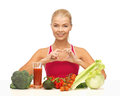 Woman with organic food showing heart shape hands Royalty Free Stock Image