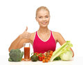 Woman with organic food young showing thumbs up Royalty Free Stock Photo