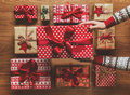 Woman organising beautifully wrapped vintage christmas presents on wooden background, image with haze Royalty Free Stock Photo