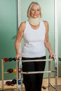 Woman with a orthopedic neck using the walker Royalty Free Stock Photo