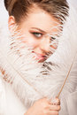 Woman with ostrich feather portrait of attractive young makeup holding Stock Image