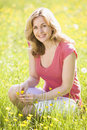 Woman outdoors holding flower smiling Royalty Free Stock Photo
