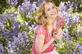 Woman outdoors holding flowers smiling Stock Images