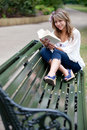 Woman outdoors reading Royalty Free Stock Photo