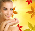 Woman over autumn background Stock Image